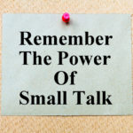 Remember The Power Of Small Talk written on paper note pinned with red thumbtack on wooden board. Business conceptual Image