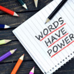Words have power text on notepad and colorful pencils